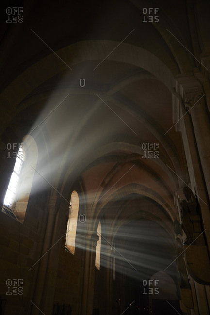 Rays of sunlight streaming through windows of Bamberg Cathedral, Germany