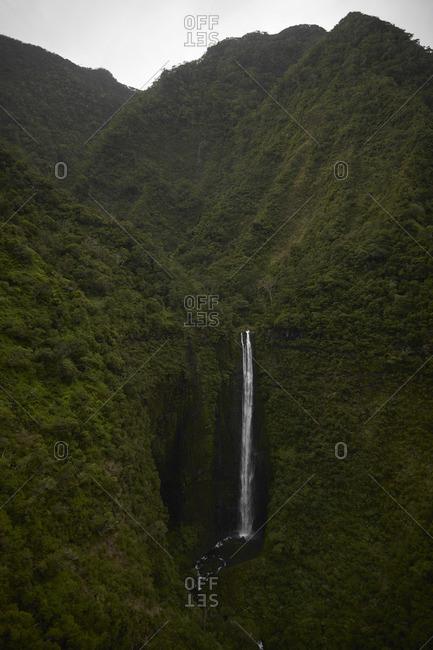 Pristine jungle waterfall in Kauai, Hawaii