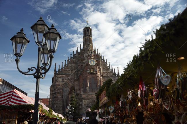 Nuremberg, Germany - December 22, 2015: Street market below the Frauenkirche