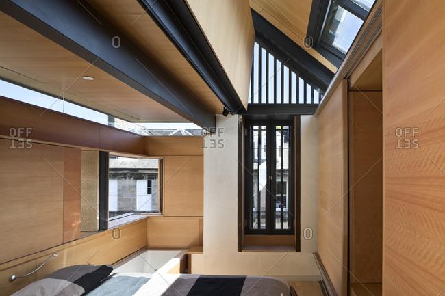 Edinburgh, Scotland, UK - May 2, 2015: Modern bedroom with skylights