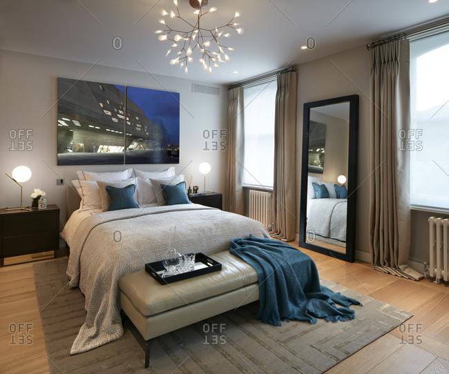 London, UK - September 23, 2015: Elegantly furnished bedroom