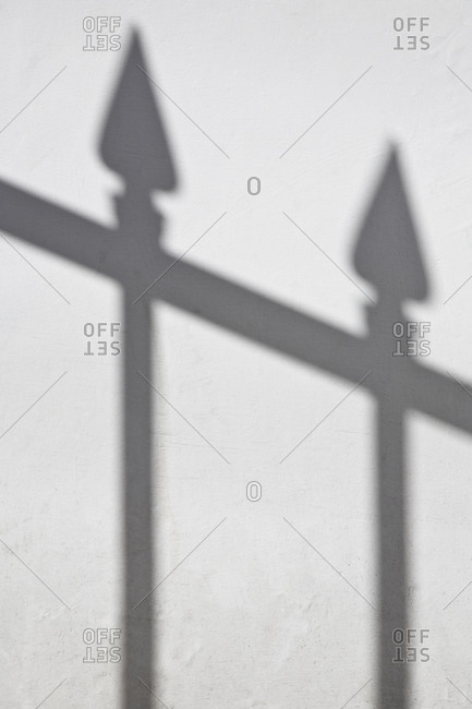Shadow of railings on ground