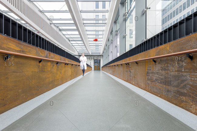 Rotterdam, The Netherlands - March 15, 2016: Woman walking down a corridor in the Erasmus University Medical Center in Rotterdam, Netherlands