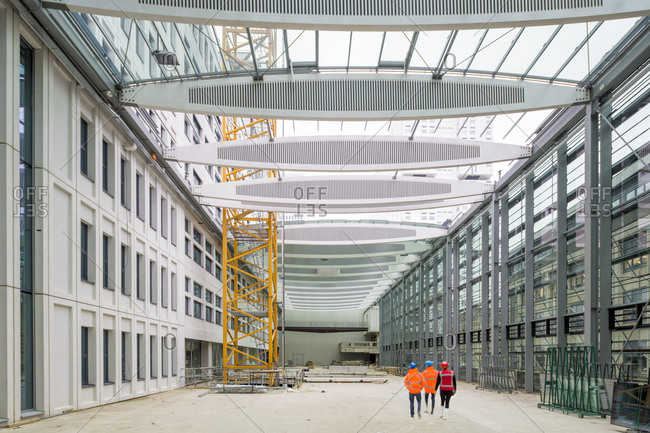 Rotterdam, The Netherlands - March 15, 2016: A group wearing hard hats inspecting an interior space still under construction at the Erasmus University Medical Center in Rotterdam, Netherlands
