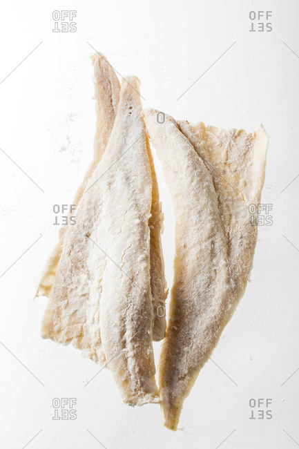 Bacalao fish filets on a white background