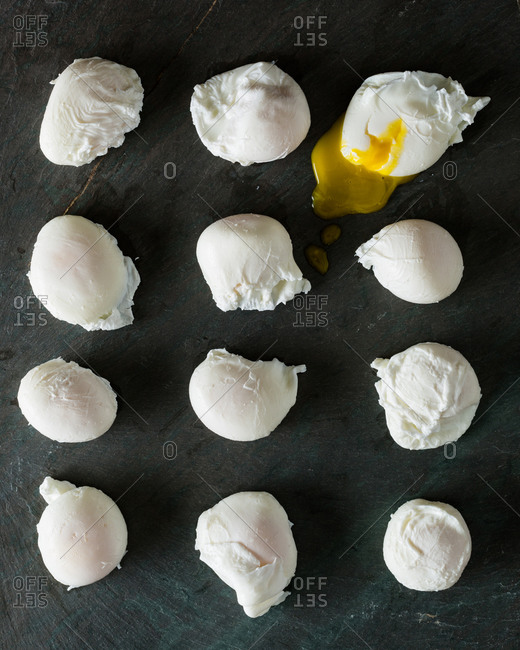 Poached eggs on a stone table