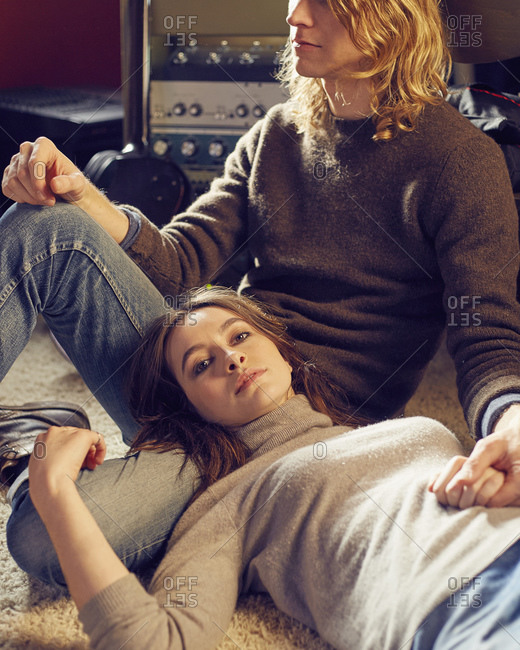 Stylish young couple relaxing together on a floor