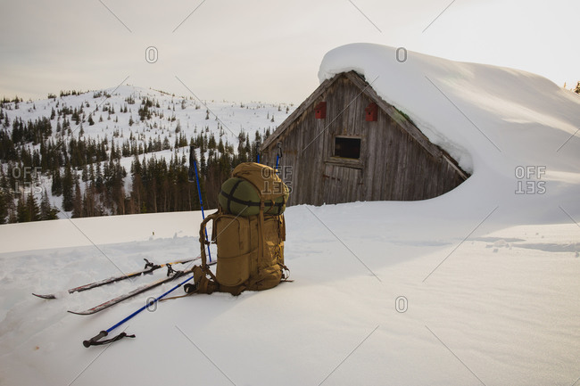 Backpack near snow covered lodge