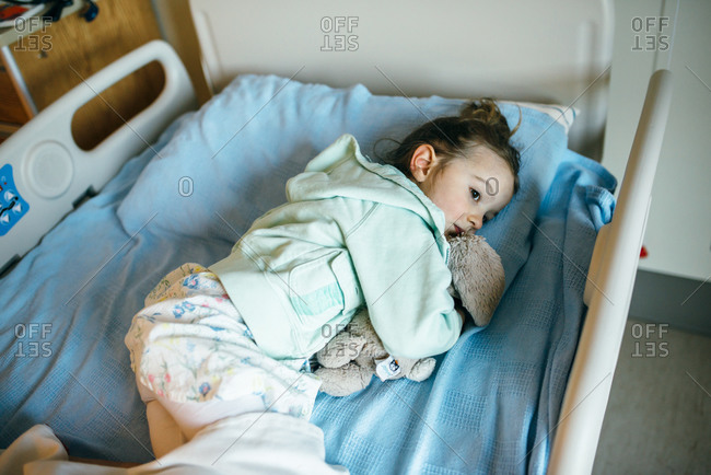 Little girl lying in a hospital bed