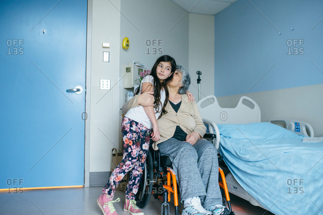 Girl and old woman in hospital