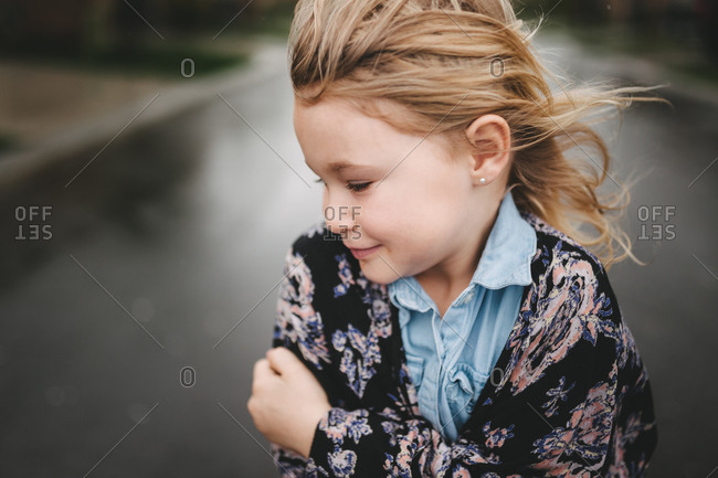 Little girl hugging herself on a windy day