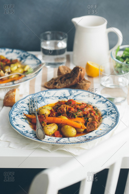 Hearty dish of braised meat with vegetables on a table