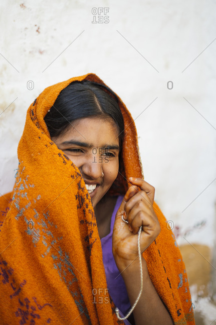 Woman covering face with sari in India