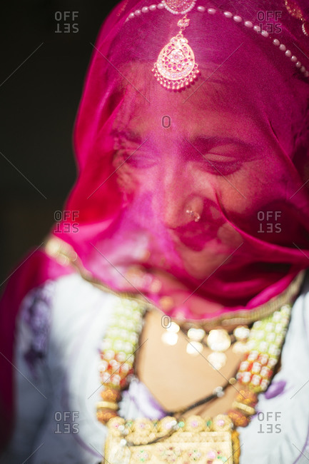 Woman with veil hiding face in India