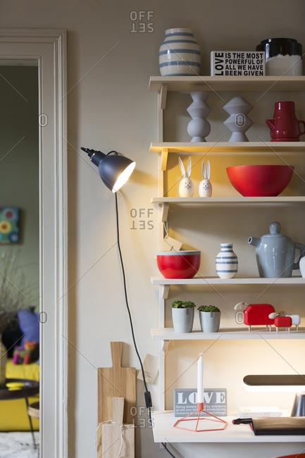 Lamp illuminating shelf and items