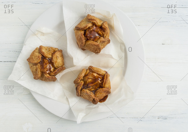 Crispy apple tarts on parchment paper