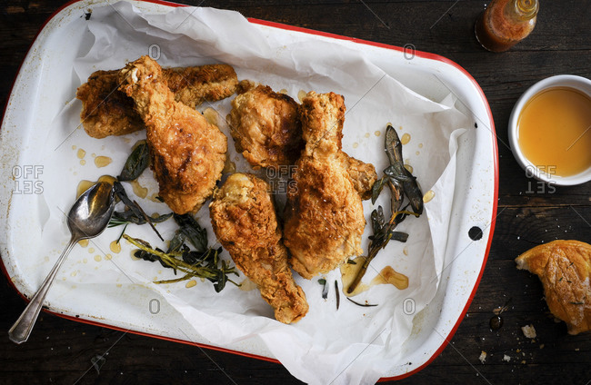Honey and sage fried chicken with honey, sage, hot sauce and biscuit