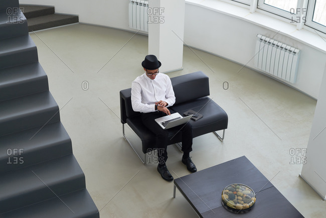 High angle view of man using a laptop