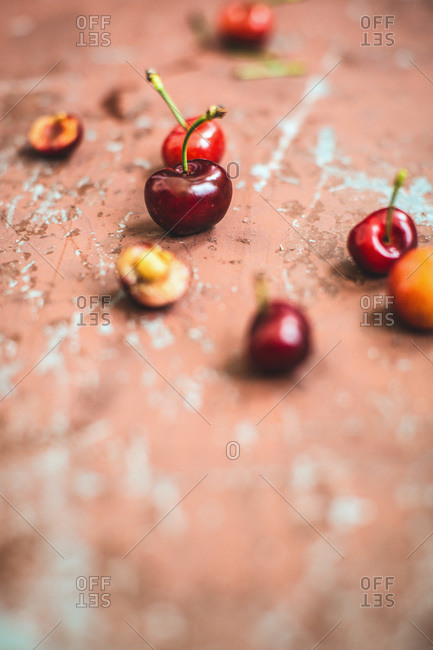 Cherries on weathered painted surface