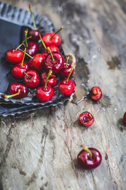 Fresh cherries on a stack of vintage tins