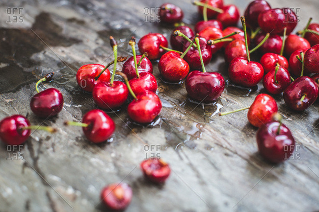 Fresh cherries scattered on wooden background