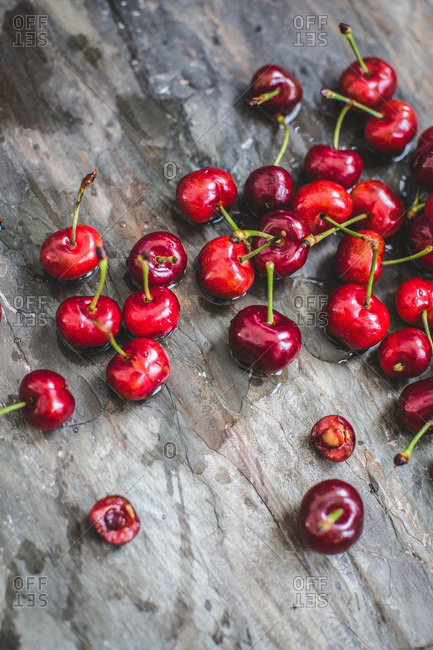 Overhead of fresh red cherries on wooden background