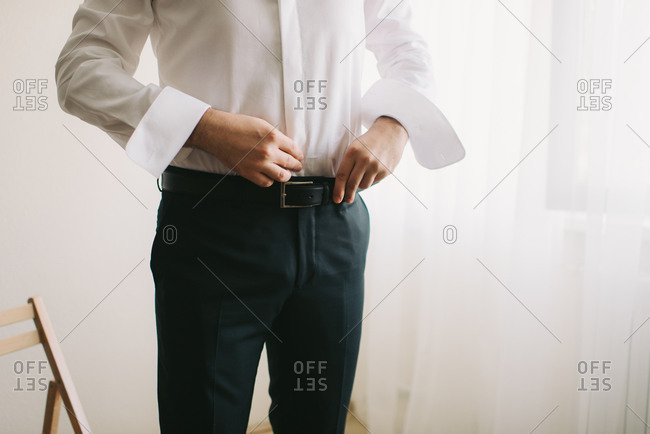 Groom getting dressed on his wedding day