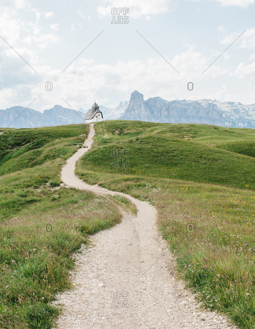 Gravel path leading to a church in the Dolomites in Italy