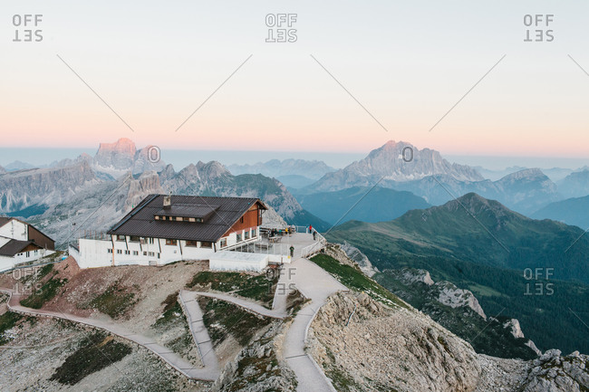 People gathered on an observation deck at a lodge in the Dolomites in Italy