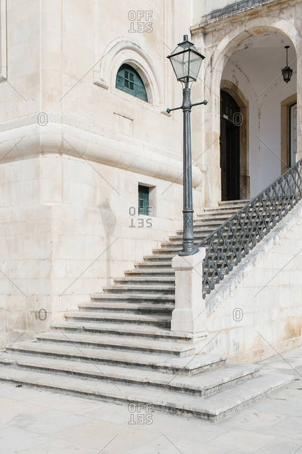 Detail of stone steps leading to the arched entryway of a classical building