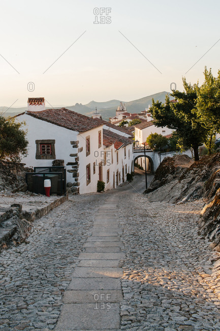 Stone path leading downhill into a small town