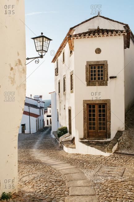 Narrow street winding through a small village
