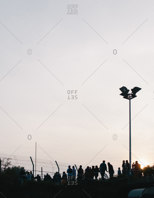 Silhouette of fans gathered at the Warneton Raceway in Belgium