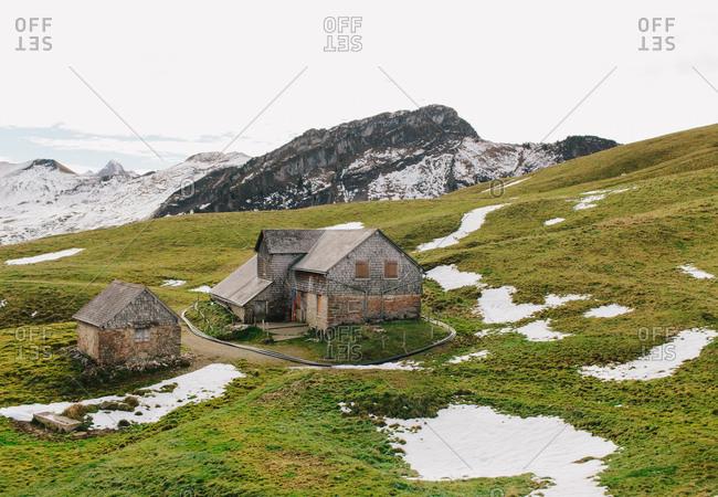 Small house nestled on a rural hillside in Switzerland