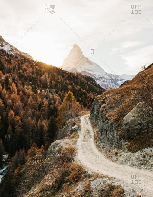 Sunlight streaming over a mountain ridge near the Matterhorn in Switzerland