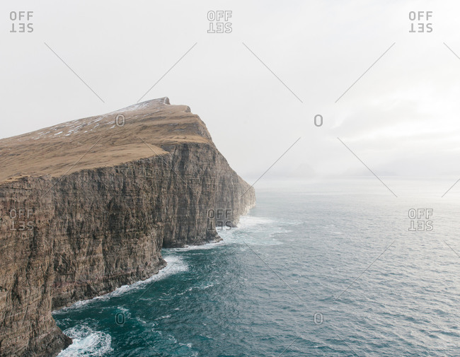 A rugged outcropping rising from the sea in the Faroe Islands
