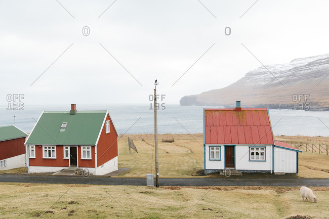 Small cottages along the edge of a bay in the Faroe Islands