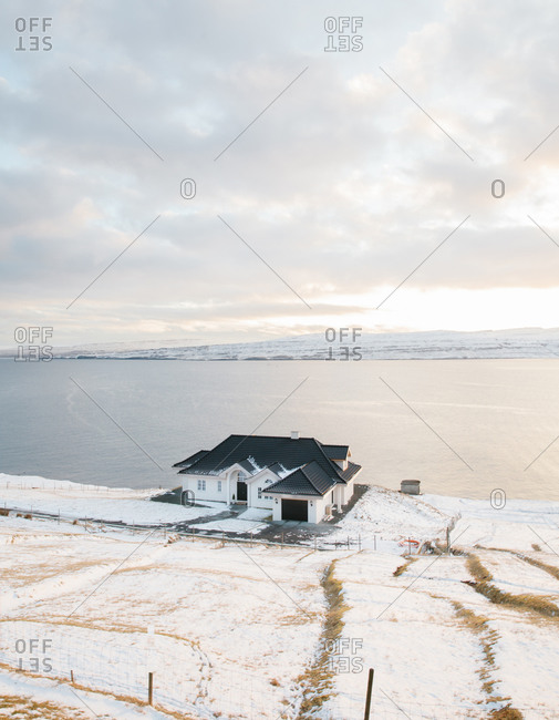 House along the edge of a bay in the Faroe Islands