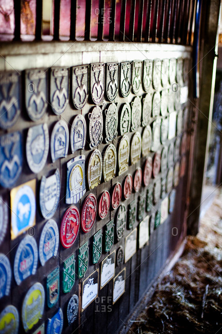 Variety of badges displayed on wooden wall