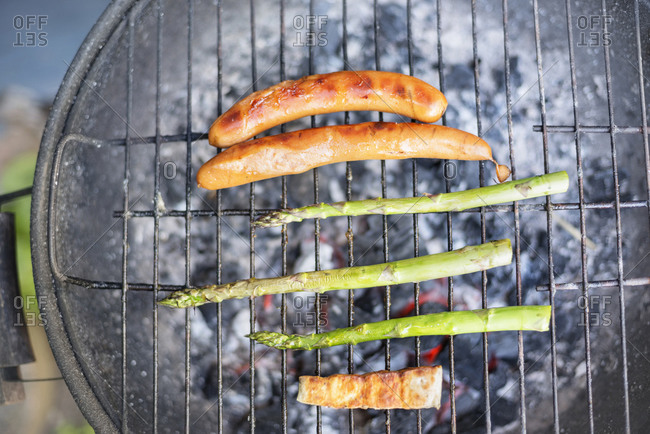 Sausages and asparagus on grill