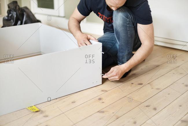 Man assembling of furniture