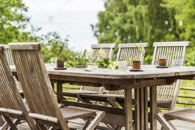 Table in garden with cups
