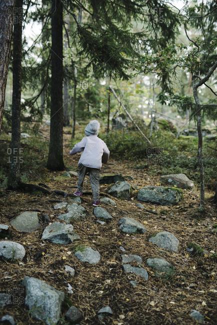 Boy walking in forest