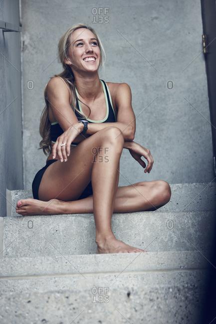 Athlete sitting on steps