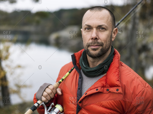 Portrait of man with fishing rod