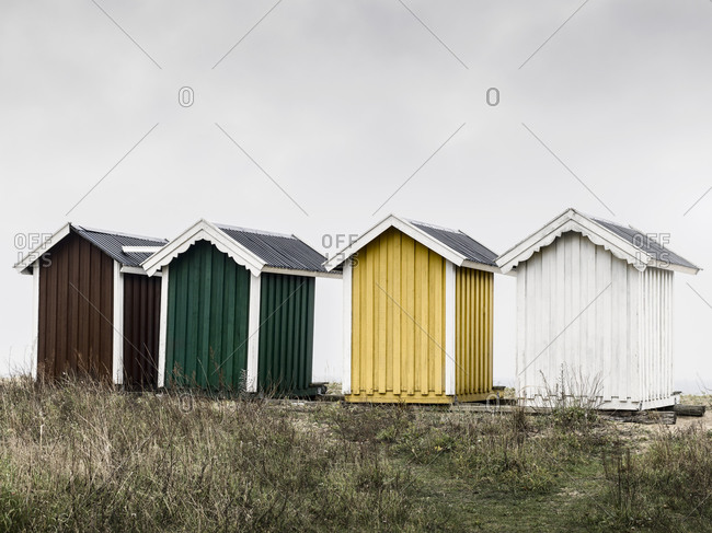 Wooden huts against overcast sky