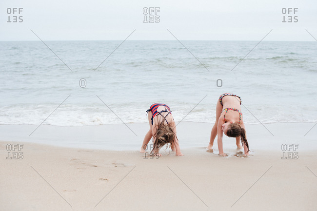 Two girls playing at the beach together
