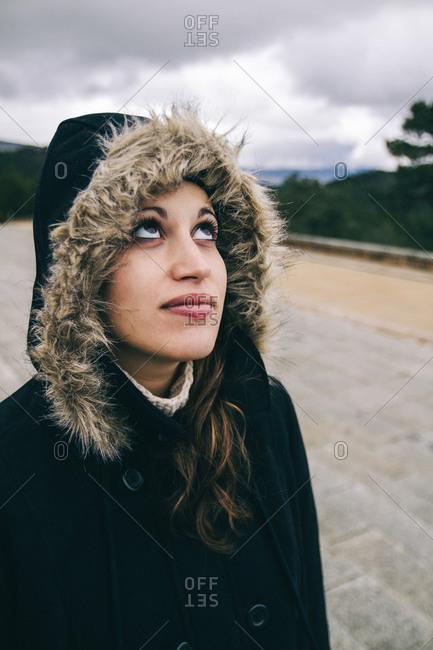 Caucasian woman looking upward