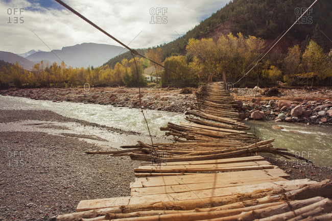 Wooden bridge over remote river