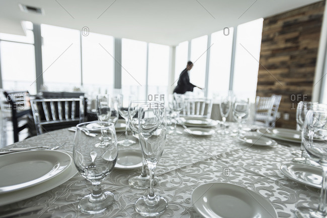 Table setting in empty restaurant